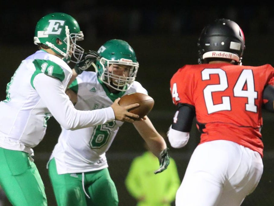 Easley's Dalton Black (11) hands the ball off to Will Drawdy (6) Friday at Hillcrest.