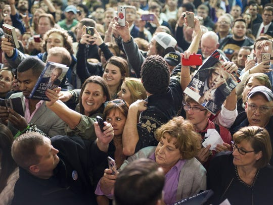 Supporters vie for autographs from Republican presidential