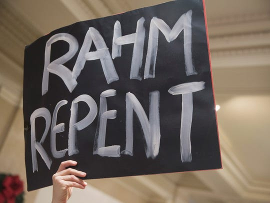 Demonstrators protest outside the office of Mayor Rahm