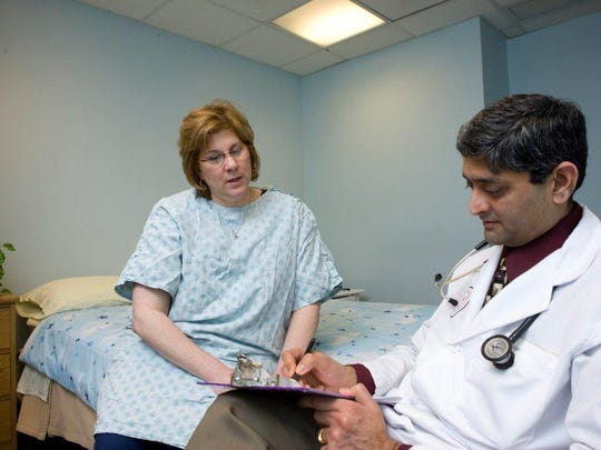 Dr. Jag Sunderram with a patient at Robert Wood Johnson University Hospital's Comprehensive Sleep Disorders Center