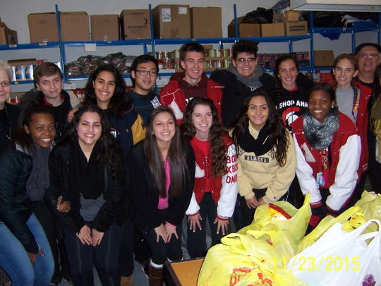 Students from Bishop Ahr High School in Edison helped in the recent distribution of turkeys and bags of Thanksgiving food items at the Perth Amboy St. Vincent dePaul Food Pantry. More than 250 families were beneficiaries of the local churches, organizations and individuals who donated to make this a special day for the needy families in Perth Amboy. School leaders have been bringing seniors to the pantry for many years during Thanksgiving week to distribute turkeys and groceries. The students have a greater appreciation of the less fortunate, after seeing their circumstances first hand, said pantry volunteer Jerry Yaros..