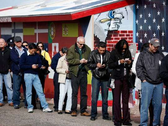 Customers wait in line at The Last Stop to buy Powerball