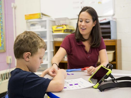 Student Liam Wilson and teacher Valerie Carmack work together on strengthening communication skills at The Bancroft School in Haddonfield.