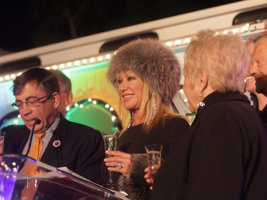 Palm Springs Mayor Robert Moon (left) and Suzanne Somers (center) toast to the one-year anniversary of the Buzz bus in downtown Palm Springs in January 2016.