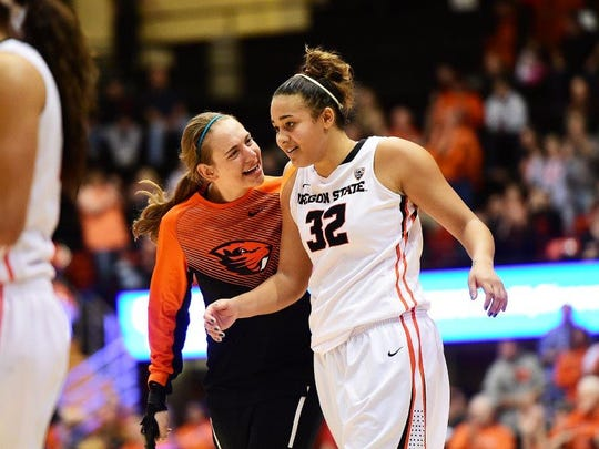 OSU forward Deven Hunter (right) with teammate Sydney Wiese during the Stanford game, had 19 points and 12 rebounds against the Cardinal in a 58-50 victory at Gill Coliseum on Jan. 17, 2016.