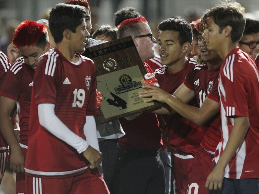 Desert Mirage High School, in red uniform, remained undefeated with a record of 23-0 after beating Shadow Hills High School during their CIF championship match at Rancho Mirage High School on March 4, 2016. Desert Mirage won 2-0.