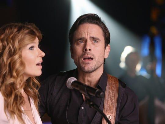 "Connie Britton and Charles Esten perform in ABC's ""Nashville,"""