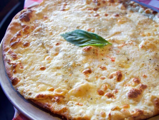 The white pizza from Grimaldi's Pizzeria is made with
