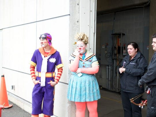 A clown wipes away a tear outside the Ringling Bros.and