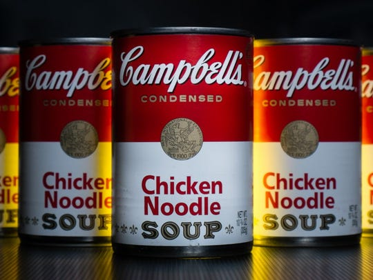 In this Wednesday, Jan. 8, 2014, file photo, cans of