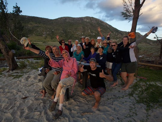 """Yvonne, in front in pink, joins fellow Wild Earth Explorers in observing the great Aussie tradition of """"Sundowners"""" on Lizard Island in the Great Barrier Reef."""