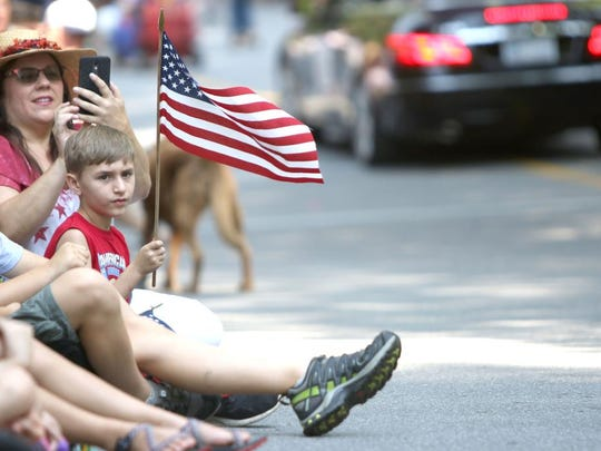 Hayden Heglar of Lincolnton; age 9, waves a flag during