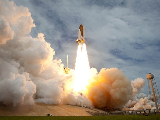 Space shuttle Atlantis launches from pad 39A on Friday,