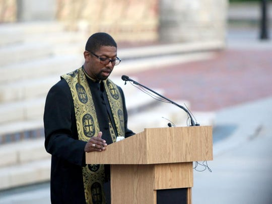 """The Rev. James Lee speaks during an Interfaith Unity Gathering at Pack Square Park. While a critic of what he says is a historic bias in policing, Lee had praise for Chief Tammy Hooper, saying he was """"excited"""" to have a chief who he said was listening to black residents."""