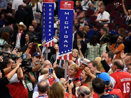 The Michigan delegation, after passing on their first roll call vote, casts their votes during the Republican National Convention in Cleveland July 19, 2016.