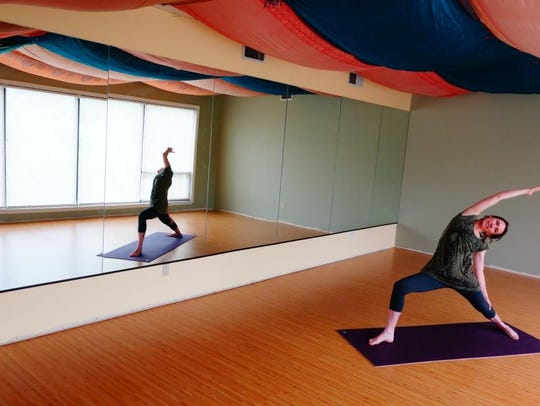 To find a yoga class held in Blue Lotus' newly expanded