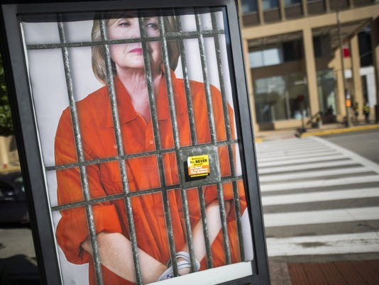636047835139064982-clinton-behind-bars.JPG.jpg