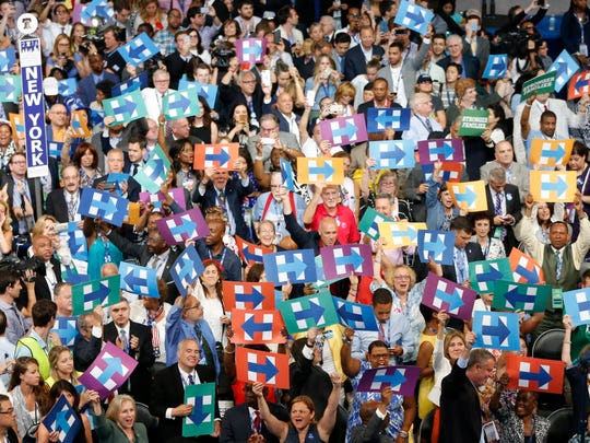 Hillary Clinton supporters from New York cheer after