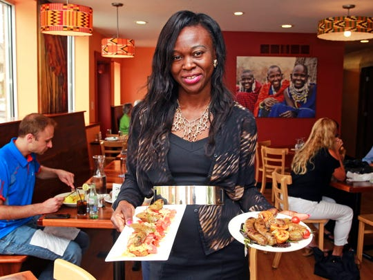 Owner Yollande Deacon of Irie Zulu in Wauwatosa holds