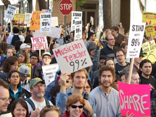 636069676973570579-INCOME-INEQUALITY-file-photo-of-Oakland-protest-by-Brian-Sims-via-Creative-Commons.jpg