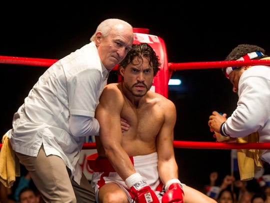 """This image released by The Weinstein Company shows Robert De Niro, left, and Edgar Ramirez in a scene from, """"Hands of Stone."""" (Rico Torres/The Weinstein Company via AP)"""