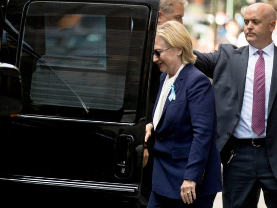 "Democratic presidential candidate Hillary Clinton gets into a van as she departs an apartment building Sunday, Sept. 11, 2016, in New York. Clinton's campaign said the Democratic presidential nominee left the 9/11 anniversary ceremony in New York early after feeling ""overheated."""