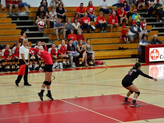 Pacelli's  Danielle Filtz serves up a point during