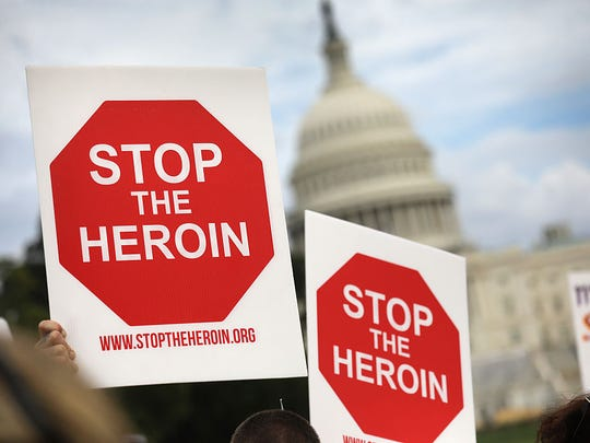 "Activists and family members of loved ones who died in the opioid/heroin epidemic take part in a ""Fed Up!"" rally at Capitol Hill on September 18, 2016, in Washington, DC. Protesters called on legislators to provide funding for the Comprehensive Addiction and Recovery Act, which Congress passed in July without funding. Some 30,000 Americans die each year due to heroin and painkiller pill addiction in the United States."