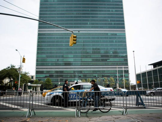 Officers keep watch across the street from United Nations