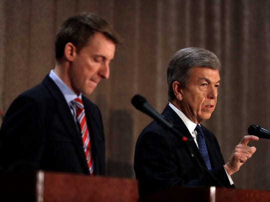 Republican incumbent Sen. Roy Blunt, right, speaks alongside Democratic challenger Jason Kander during the first general election debate in Missouri's race for U.S. Senate at the Missouri Press Association convention Friday, Sept. 30, 2016, in Branson, Mo.