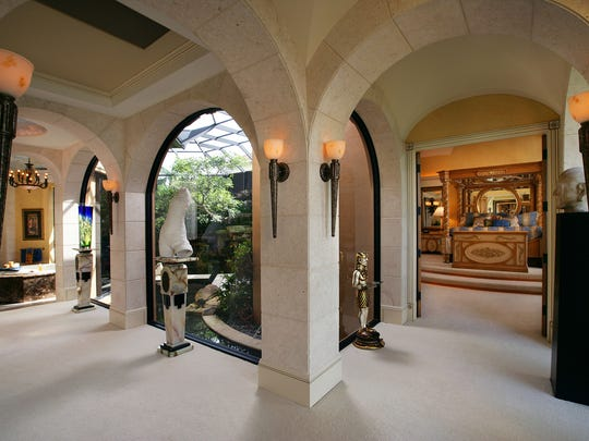The master suite includes an ornate bedroom, a bathroom