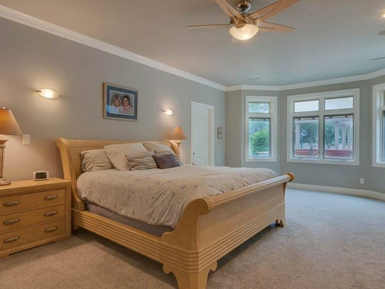 The master bedroom has a great view of the pool.