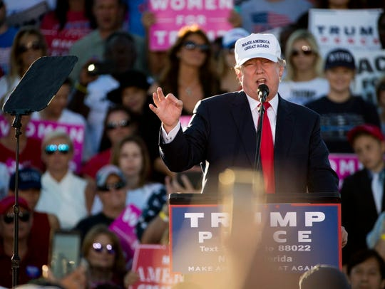 Donald Trump speaks during a rally at Collier County