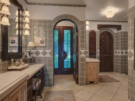 The master bathroom features Italian marble sinks and flooring.