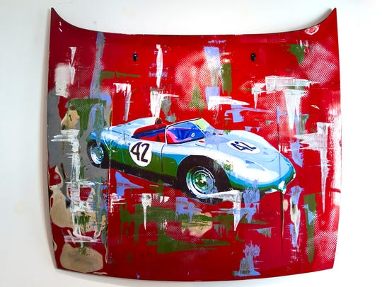 Karen Barrow's work available at HW Gallery in Naples includes this mixed media painting of a 1960 Porsche racing car painted on a 1984 Porsche 944 hood.