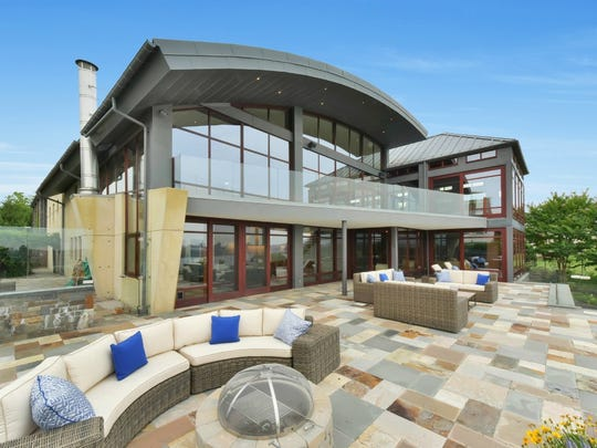 The asking price on this Fort Lee contemporary was cut from $18.9 million to $10 million. It's still on the market.