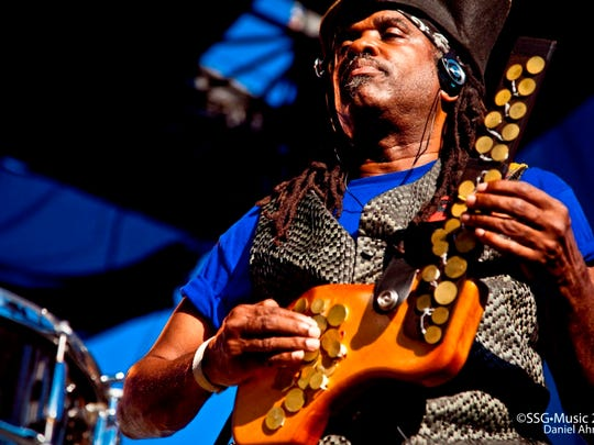 """Roy """"Future Man"""" Wooten taps out intricate drum patterns on his Synthaxe Drumitar."""