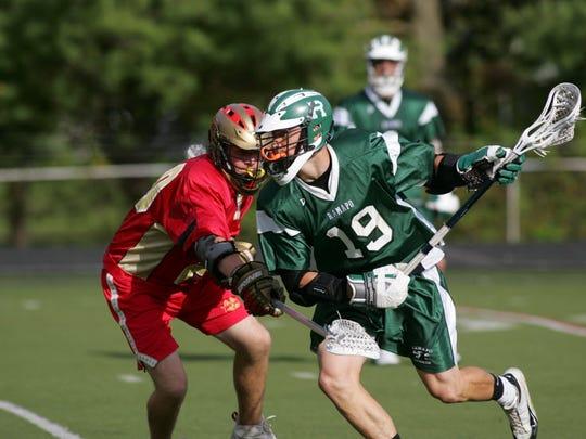 Chris Hogan of Ramapo lacrosse runs past Greg Certo of Bergeh Catholic on May 3, 2006.