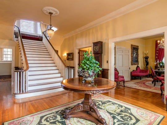 The amazing entrance features a sweeping staircase and full parlour.