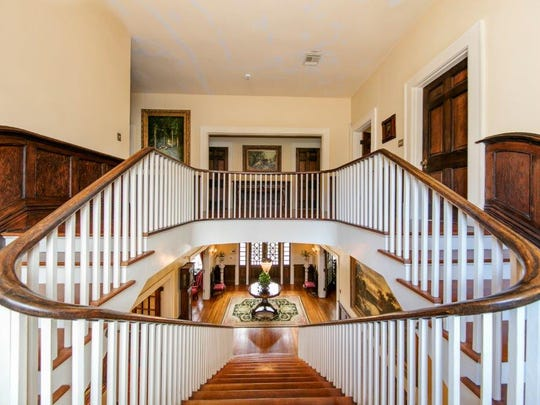 The antebellum staicase leads to a second story with fabulous wood floors and trim.