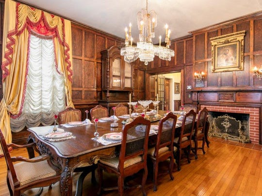 The grand formal dining room is large and luxurious.