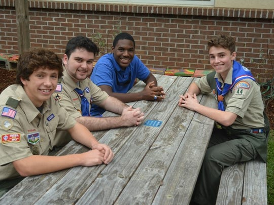 Henry sitting at a refurbished table in the Temple Israel garden, with Scouts Torry Wagner and Thomas Stansbury, and good friend Christian Butts