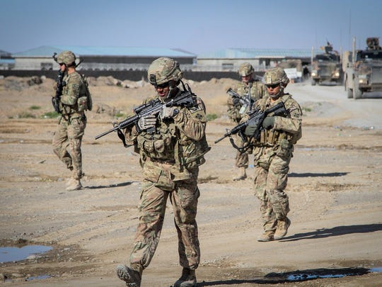 Soldiers assigned to the 65th Engineer Battalion conduct a presence patrol in Kandahar province, Afghanistan, in 2014. The U.S. continues to train, advise and assist Afghan forces years after the American combat mission there ended.