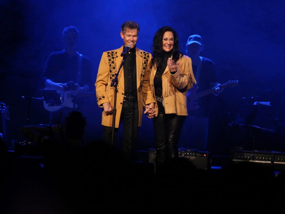 Randy Travis' road back from a near-fatal stroke has been grueling,