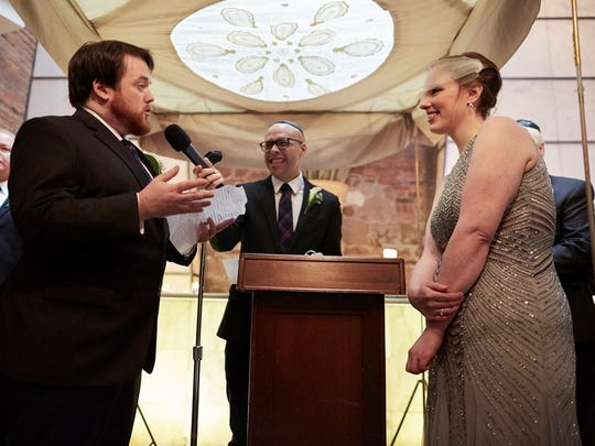 Tristan Cooper, Silverton, and Joanna Champion, Rochester, exchange vows during their wedding in January