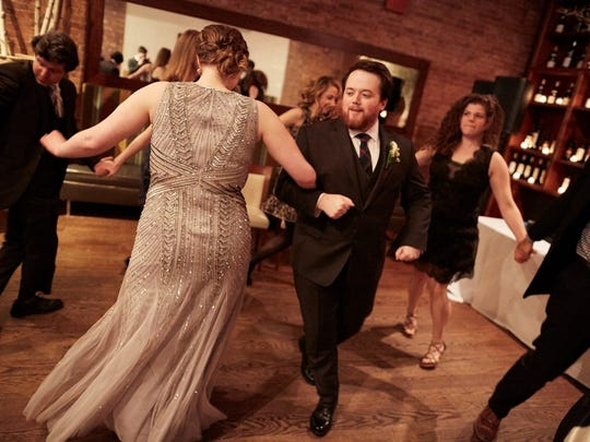 Joanna Champion and Tristan Cooper take to the floor during their wedding reception