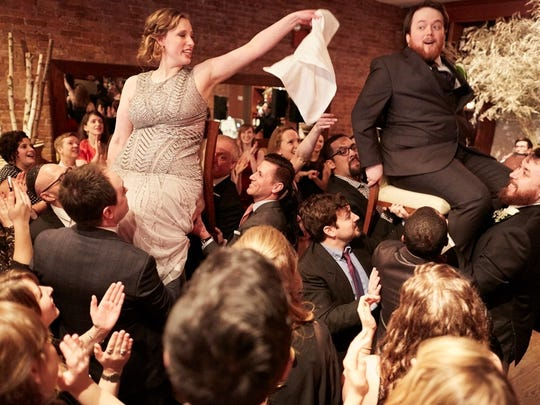 Newlyweds Joanna Champion and Tristan Cooper are the center of attention during the hora