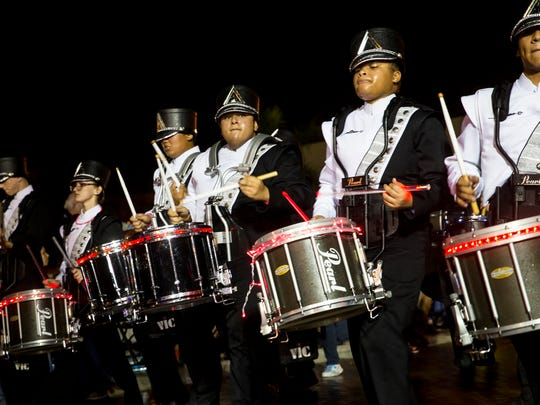 The Mariner High School Marching Band drumline performs during The Edison Festival of Light Grand Parade in downtown Fort Myers, Florida on Saturday, Feb. 18, 2017. Named as the largest night parade in the Southeast year after year, the parade brings the entire Southwest Florida community out in celebration of the life and achievements of our local winter resident, Thomas Edison.