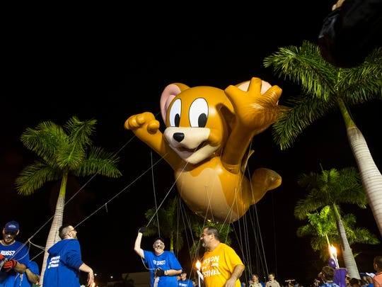 Jerry the Mouse glides down the street with Fort Myers