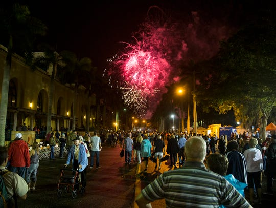 The crowd watches the finale fireworks display during